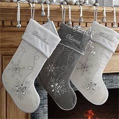 LOVE these sparkly silver and white personalized snowflake stockings! You can embroider them with any name for a perfect winter wonderland Christmas mantle theme! SO Pretty!