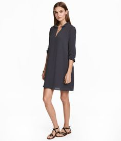 Check this out! Straight-cut, V-neck dress in crêped fabric with ruffle details. 3/4-length sleeves with small ruffle and narrow elastication at cuffs. Fully lined. - Visit hm.com to see more.