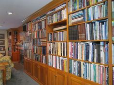 """This photo shows almost the entire length of our living room/dining room bookshelves. It appears neater than it really is. The books are arranged by size rather than subject. I usually know where each book is, but sometimes I discover a book I forgot I had in a search for another. There are two other libraries in our house of smaller size, but they are currently in rooms undergoing renovation. At one point, it was pointed out to us that we needed to remove some books from our second…"