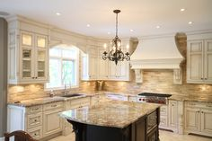 Built in fume hood. Top Notch Cabinets - Kitchens. Traditional classic french country kitchen white Just not loving the backsplash