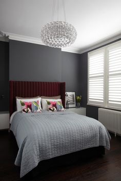 maroon accent wall with gray other walls - maybe for the den