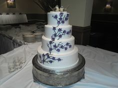 Wedding cake Birds and japenese cherry blossom design. Purple flower accents. Cakes By Mindy At Receptions www.receptionsinc.com/weddings/cakes