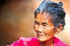 A-portrait-of-an-old-Burmese-woman.