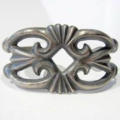 Sand-cast Sterling Silver Navajo Bracelet. To sand-cast a piece the artist makes a mold out of sand and then pours metal into the mold. Once the metal cools the artist peels the sand away to reveal the finished product!