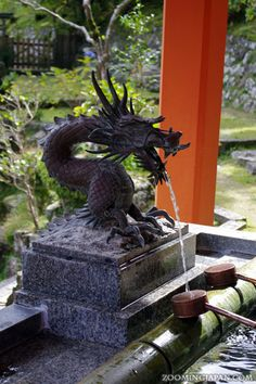 A dragon pond to purify yourself before you pray to the gods. This one was at a shrine in the Kumano region of Wakayama Prefecture.