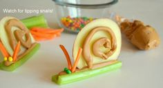 A great healthy kids snack! Celery Snails! Just a thin sliced apple peanut butter and some shredded carrot and peas and of course celery! *allergy alert*
