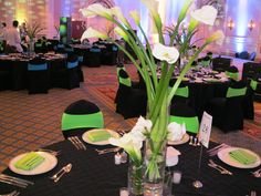 Soft accent lighting and high/low floral touches create dimension throughout a space.  www.konceptevents.com