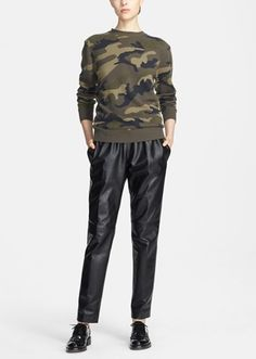 Head to toe Valentino. Love this camo cashmere sweater and leather track pants pairing.