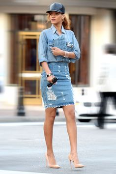 Rihanna. Denim skirts are having a moment, and a distressed pencil skirt and shirt combination gives workwear an edge, paired with blush heels.