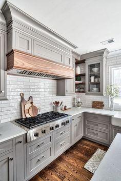 Kitchen hood mantel The custom kitchen hood features a mantel is Natural Walnut hood mantel #hoodmantel #kitchen #hood #kitchenhood