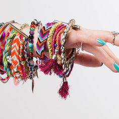 Bright, stacked bracelets—an easy way to add a pop of fun to a laid-back look.