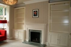 fireplace with fitted alcove cupboard / cabinet / shelves