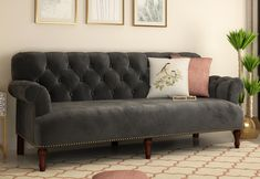 Parker offers sumptuous comfort in luxurious footprint. Distinguished by set-back rolled arms, nailhead detailing and graphite color fabric print, this sofa is sure to add charm into your home. Buy in online from #woodenstreet #sofa #sofas #interiordesign #furnitures #chesterfieldsofa