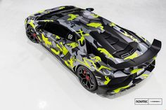 Novitec Torado Lamborghini Aventador SV Sports CamoBull Wrap! This Novitec Torado Lamborghini Aventador SV Sports CamoBull Wrap shows that an Abetador can get even more special once you go to Novitec Torado with it and have the guys there work their magic on the supercar. The camouflage neon, gray and black wrap is the color scheme that the guys decided to...
