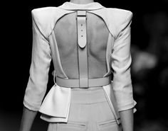 Looks a little dominatrix but I love buckles. I assume this is a jacket. Very avante garde.