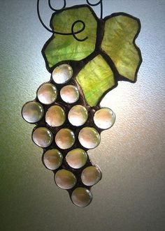 Stained glass grapes and leaves.