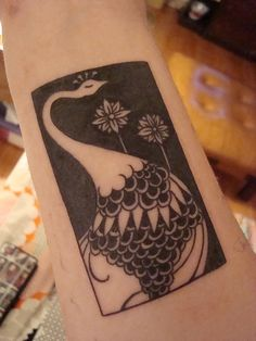 This peacock design is based off of a drawing by Aubrey Beardsley.
