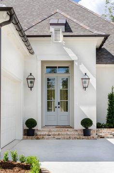 Covered entry way with double entry doors. Covered entry way with double entry doors. Stucco House Colors, White Stucco House, White Brick Houses, Exterior Paint Colors For House, Paint Colors For Home, Stucco Homes, Stucco Exterior, Exterior Design, Home Exterior Makeover