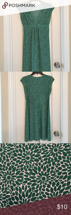 "Super cute green floral dress☘️☘️☘️ Sleeveless V-neck style with a tie in back. 16"" across bust, 13"" across below bust at tie line. Great for St. Patrick's day! Cute dress!💚💚 Wishes, wishes, wishes Dresses"