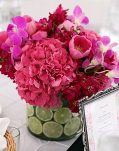 WeddingChannel Galleries: Lime Filled Vase and Pink Sweet Pea Centerpiece