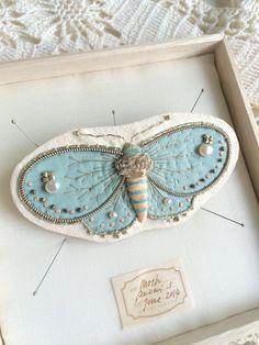 Broche papillon Zoomy