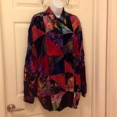 New Listing!Beautiful colored button down shirt Gorgeous shirt with a lining. Has a mix of colors. Colors include -burgundy, purple, black, blue and green. Material is 100% rayon. Sleeves button up as well. This is such a pretty shirt! Should be drycleaned. Tops Button Down Shirts