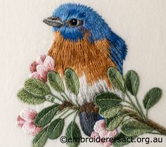 Detail 2 of Eastern Bluebird stitched by Sharon Burrell