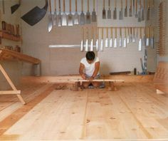 """brushfactorywoodwork: Toshio Odate in his workshop. The Workbench Book One of the more common knocks against Japanese woodworking techniques are comments to the effect of """"Why would anyone want to work on the floor?"""" The thing is, with these techniques, you aren't working on the floor. You're sitting on your workbench. Also, check out that awesome saw collection."""