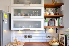 Additional open laminated wood shelves for kitchen: subway tile: small kitchen : iroko butcher block countertops : white kitchen cabinets