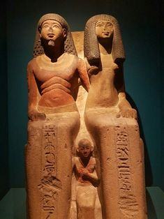 Statue of Itu,a priest and his wife Henutweret,with their son Neferhebef.Mid18th Dynasty c.a. 1400 B.C.