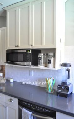 This is an idea-see how much clearance raising cabinets would give us to use other microwave on shelf under cabinets and replace current with good vent