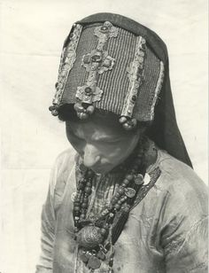 Africa | Jewish woman from Tiznit. She is wearing a 'Madhour' headdress made from woven silver, silver, enamel and stones | ©Jean Besancenot. 1935