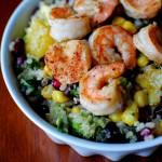 Superfood Salad with Lemon Vinaigrette pomegranate, quinoa, baby shrimp, avocado, orange, corn, kidney beans, leafy greens