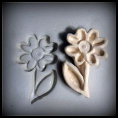 This is hand carved flower with stem and leaf patterned stamps, made out of high fired stoneware clay. This stamp is great for just one impression or a