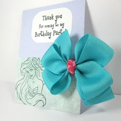 Mermaid Birthday Party Favors, Aqua Blue and Pink Hair Bow with Personalized Message. $3.25, via Etsy.