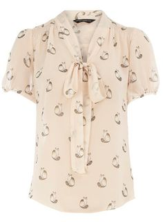 i like things with animal prints and patterns and this blouse is gorgeous!