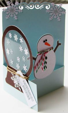 Stinkin' cute snowman /snowglobe card by bugaloo.  Love the fold technique and the interaction.  xoxo