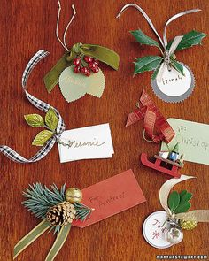Made from stationery-store supplies, ribbon pieces, and a hole punch, these gift tags are inexpensive and fun to create (clockwise from top left): The kraft-paper leaves have pinked edges, with a bunch of millinery berries and a velvet ribbon threaded through a hole punched in the corner. A round paper tag and a holly sprig are affixed with a narrow ribbon to a backdrop of two silver-foil seals glued together. A red ribbon and a miniature-sled ornament embellish a green stationery tag…