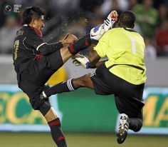 Mexico's Calderon collides with Trinidad and Tobago's goalkeeper Marchan during their CONCACAF Olympic qualifying soccer match in Carson.