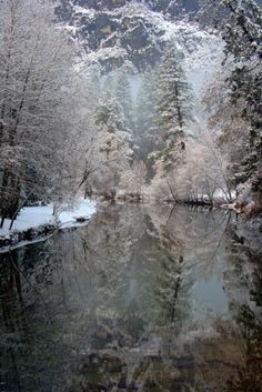 Snowy riverbank by sjulian1