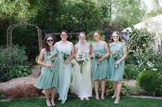 Bridesmaids wear sage green dresses from For Her and From Him. Photography by http://www.lucydavenport.co.uk/