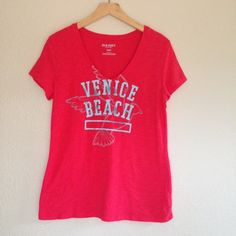 Pink Graphic Tee- Old Navy Worn a fee times, in excellent condition.  Size M.  No trades. Old Navy Tops Tees - Short Sleeve