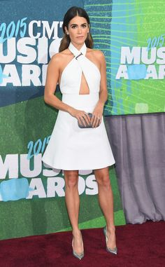 Nikki Reed wore a white Kaufman Franco halter dress with a triangle keyhole with silver pointed toe pumps. White is perfect for spring/summer! Gorgeous dress, Nikki! Beautiful!