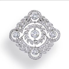 A diamond brooch designed as an openwork pavé-set diamond foliate plaque of navette outline, set with five old European-cut diamonds; old European-cut diamonds weighing approximately 3.85 carats; estimated remaining total diamond weight: 2.35 carats; mounted in platinum; length: 1 13/16in. Edwardian or Edwardian style.