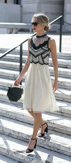 20s-inspired deco black and white beaded midi dress with pleated tulle skirt perfect for any formal or special occasion Image source