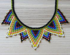 Petals Necklace - Black, Olive Green, Blue and White - Handmade by Luciana Lavin by LucianaLavin on Etsy Bead Jewellery, Beaded Jewelry, Beaded Necklace, Handmade Beads, Handmade Necklaces, Loom Patterns, Beading Patterns, Triangle Necklace, Peyote Beading