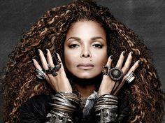 Janet Jackson will BURNITUP in whatever she wears....but we love the chunky rings. hammered bracelets, black nails, and more hair to whip are around than Nae Nae.