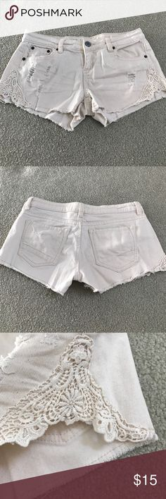 Rue 21 shorts Off white Rue 21 shorts with lace detailing on the sides. Very gently used, no rips Rue 21 Shorts