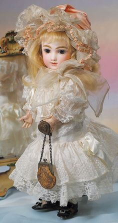 """""""A.T."""" FRENCH BISQUE BEBE BY THULLIER. Marks: A 7 T. 16"""". Bisque socket head Steiner composition jointed body with straight wrists **wrong replaced body**  Andre Thullier, circa 1882."""