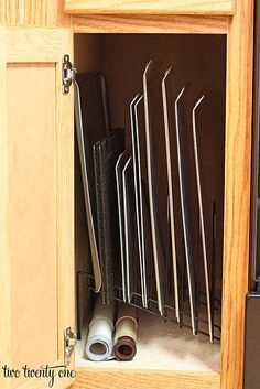 Organize lighter items like baking sheets and cooling racks with a dividing file rack.   31 Insanely Clever Ways To Organize Your Tiny Kitchen